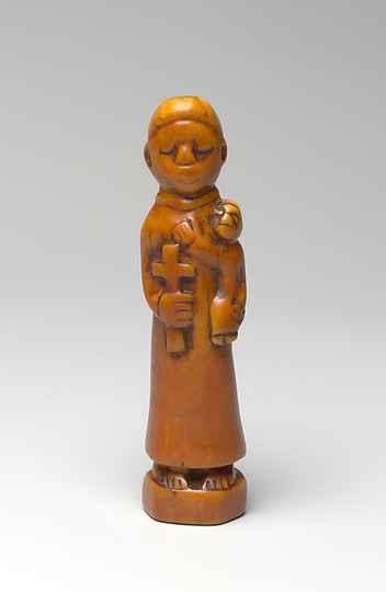 Imagem de Santo Antônio (Toni Malau), datada do século 18 e produzida em marfim (inciso de hipopótamo) por povos do Congo