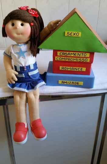 A boneca Meninagê, mascote do projeto