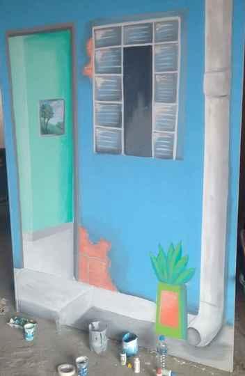 Painel do cenário da mostra Beco Negrês, produzido pelo coletivo Santa Rita.